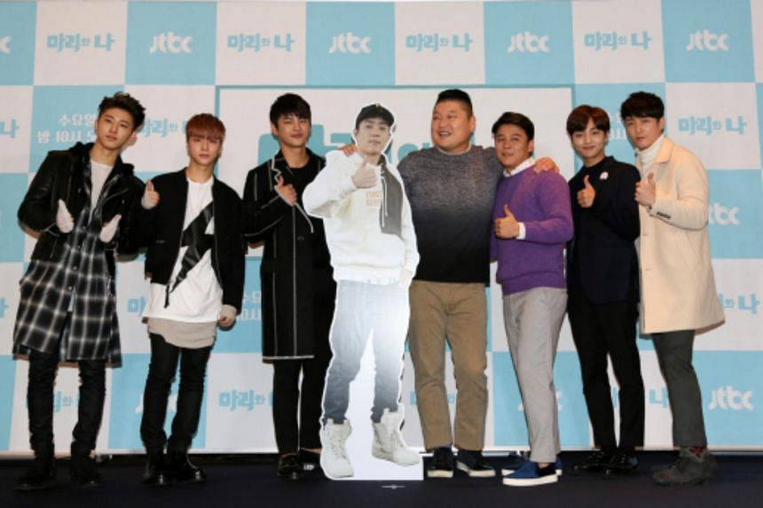 (From left) B.I, Kim Jinhwan, Seo In Guk, Eun Ji Won (cutout), Kang Ho Dong, Lee Jae Hoon, Kim Min Jae and Sim Hyoung Tak posing for the press at the Stanford Hotel Seoul on Tuesday.