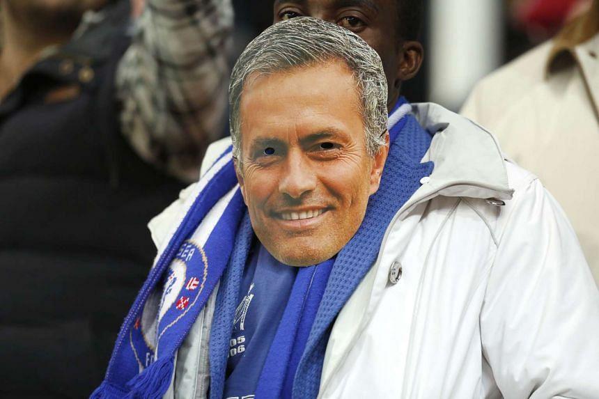 A Chelsea fan with a Jose Mourinho mask.