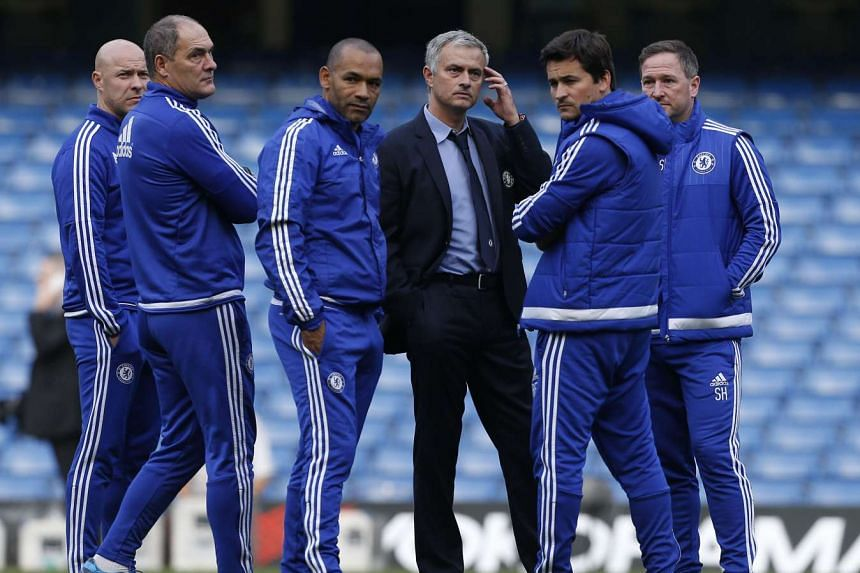Mourinho (centre) with his coaching staff after Chelsea versus Liverpool at Stamford Bridge.