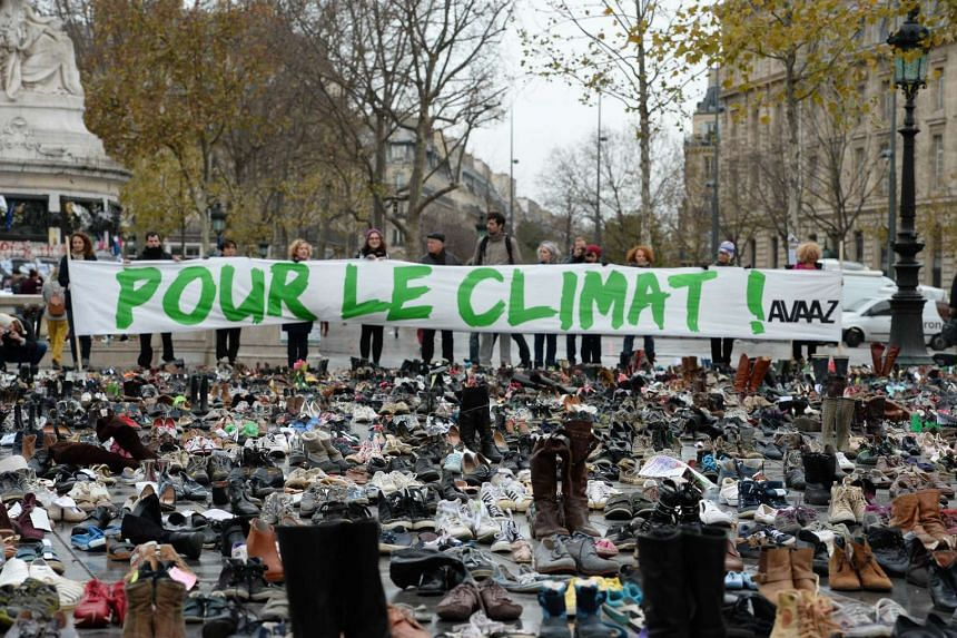 The Place de la Republique is covered in hundreds of pairs of shoes on Nov 29, 2015, in downtown Paris.