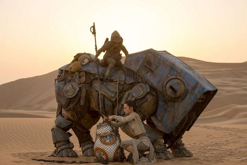 Daisy Ridley plays junk scavenger Rey in Star Wars: The Force Awakens alongside robots and alien ne'er-do-wells.