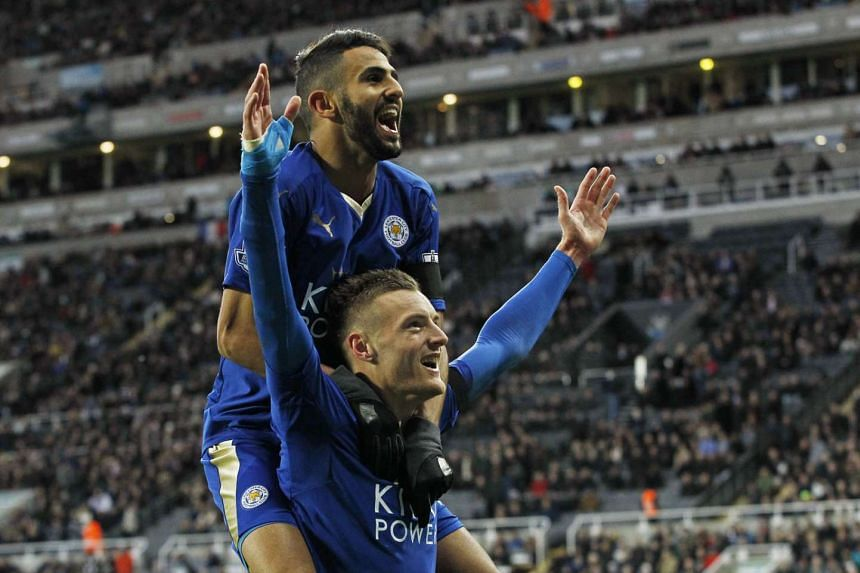 Premier League leaders Leicester City's Jamie Vardy with Riyad Mahrez (top). The low-priced duo have scored 25 per cent more goals this season than big-budget Manchester United.