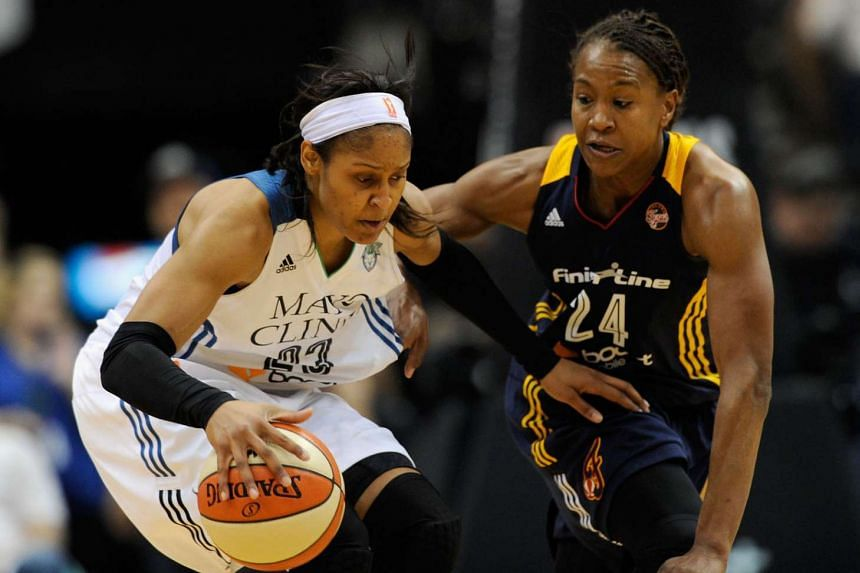 Tamika Catchings (far right) of the Indiana Fever defends against Maya Moore of the Minnesota Lynx in Game Five of the 2015 WNBA Finals on Oct 14. The Lynx defeated the Fever 69-52 to win the WNBA Championship.