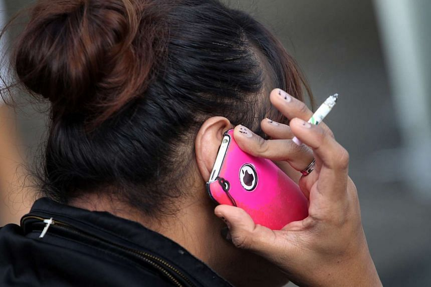 A young female smoker in Singapore.