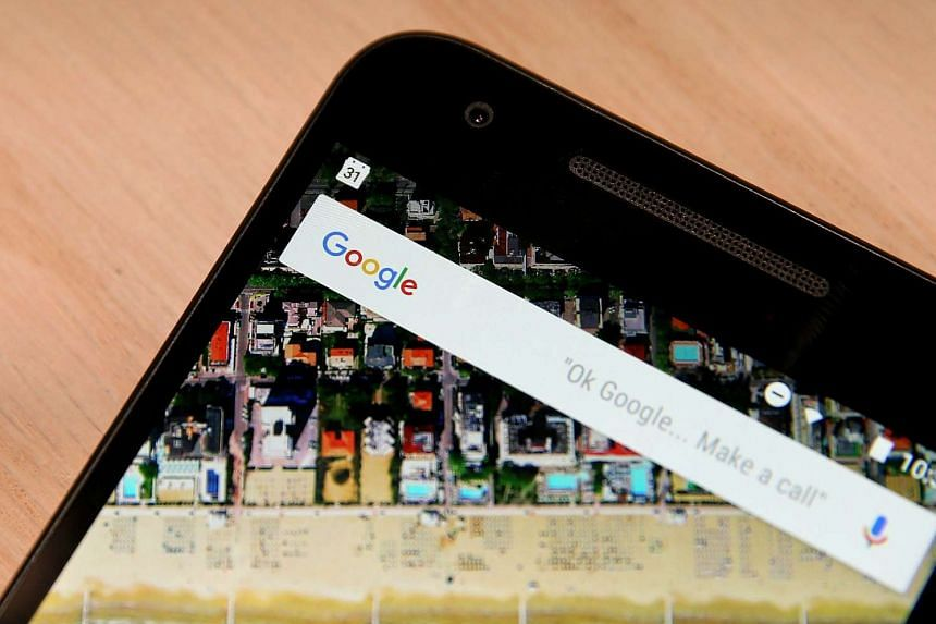 The Google logo displayed on a smartphone.