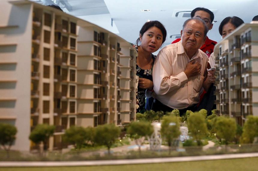 Prospective buyers viewing a model of a private condominium development during its launch in Singapore in 2013.