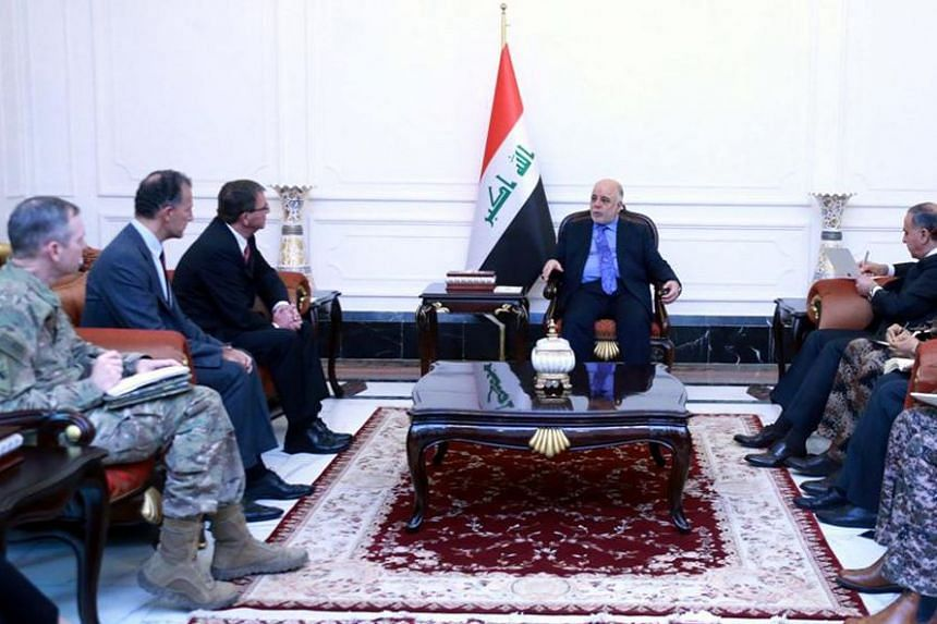 US Defence Secretary Ashton Carter (third from left) meeting with Iraqi Prime Minister Haider al-Abadi (seated alone) in Baghdad on Dec 16, 2015.