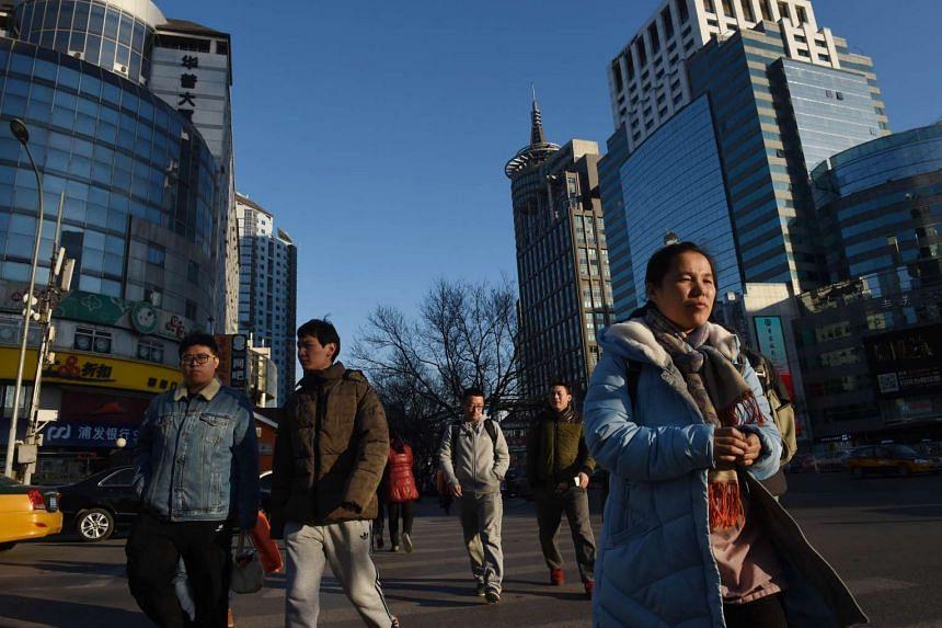 Pedestrians in Beijing on Dec 18.