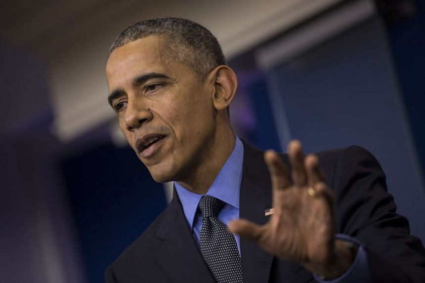 US President Barack Obama speaking at a news conference at the White House on Dec 18.