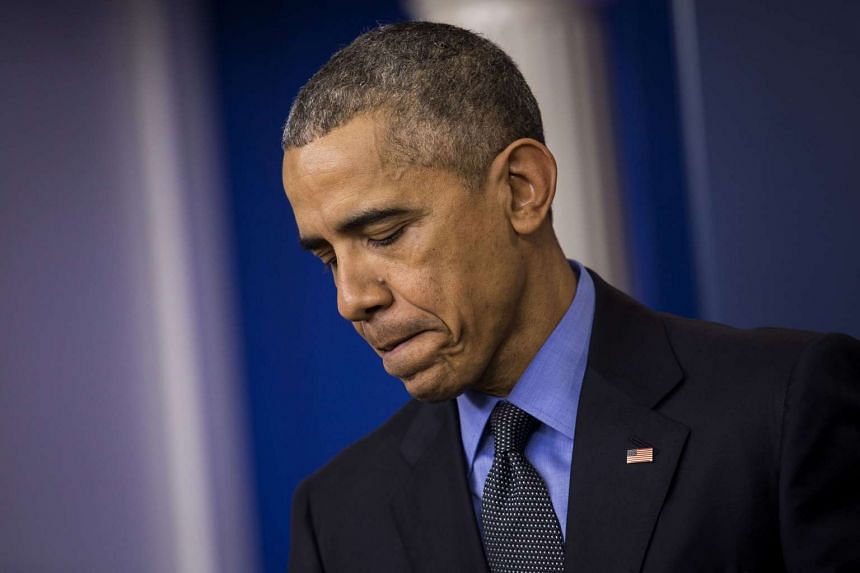US President Barack Obama pauses during a news conference at the White House in Washington, DC, on Dec 18.