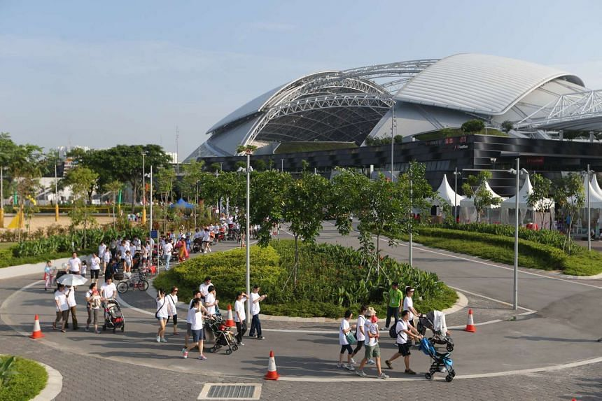 About 1,500 participants with 287 baby strollers set a new Singapore record for the largest mass stroller walk, after completing a 1.5km route around the Singapore Sports Hub.