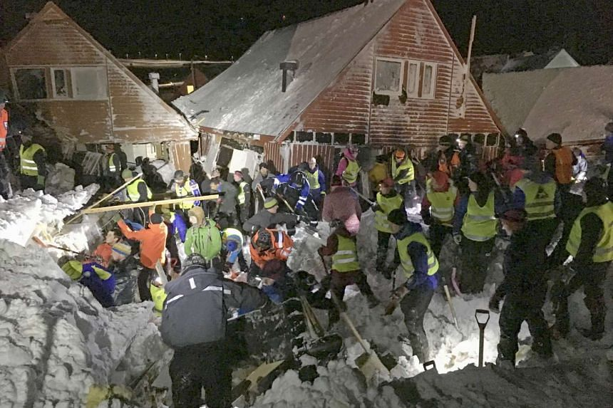 Search Crews at work where an avalanche hit several houses in Longyearbyen, Norway Dec 19 2015.
