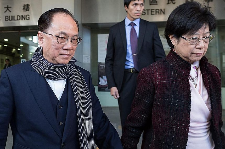 Tsang, seen here leaving court yesterday with his wife, Selina, was charged over his alleged failure to disclose plans to lease a luxury flat owned by a major investor in a broadcaster seeking a licence. He also allegedly failed to declare that an ar
