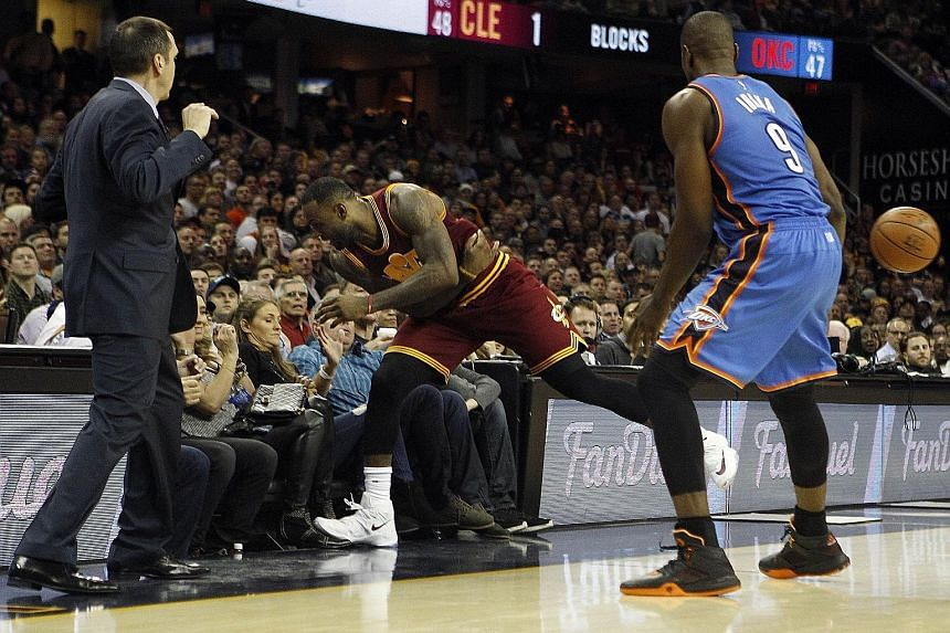 Top: LeBron James crashing into the stands in pursuit of a loose ball. Left: Ellie, wife of golfer Jason Day (above left), being stretchered off after the collision with James.