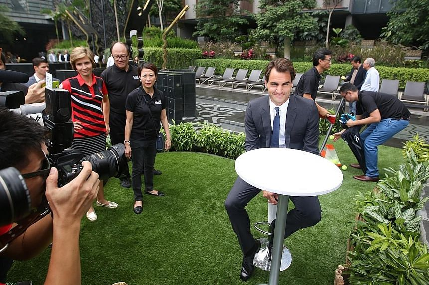 In town to play in the Coca Cola International Premier Tennis League as part of the Obi UAE Royals team, the 17-time Grand Slam champion Roger Federer met some fans yesterday at luxury condominium OUE Twin Peaks, where he also officially opened a ten