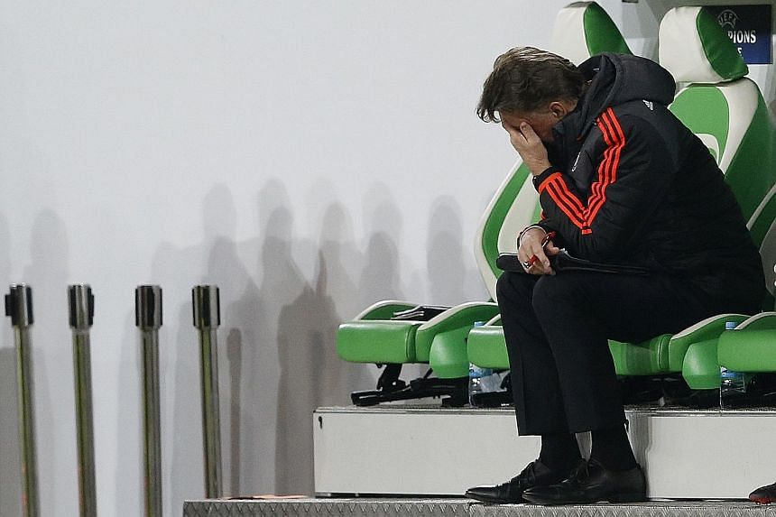 Manchester United manager Louis van Gaal looking dejected after the 2-3 loss to Wolfsburg in their Champions League group match.