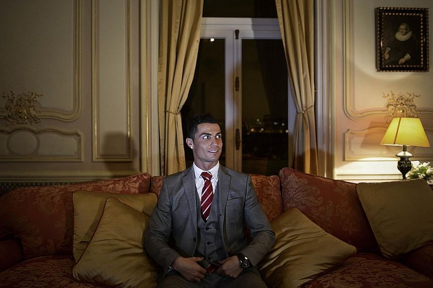 Cristiano Ronaldo, posing at the Pestana Hotel Palace in Lisbon, intends to invest more than $56.8 million in CR7 hotels in three cities linked to his career - Funchal, Lisbon and Madrid - and another in New York.