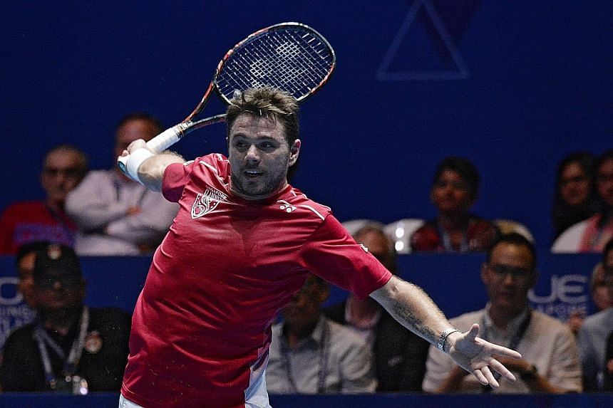Stan Wawrinka in action against Roger Federer during the opening day of the International Premier Tennis League in Singapore.