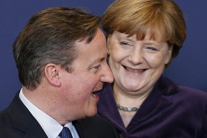Mr David Cameron with Germany's Chancellor Angela Merkel during the EU leaders summit in Brussels on Thursday. The British PM left the negotiations with an optimistic message about the prospects for a deal at the next European summit in February.