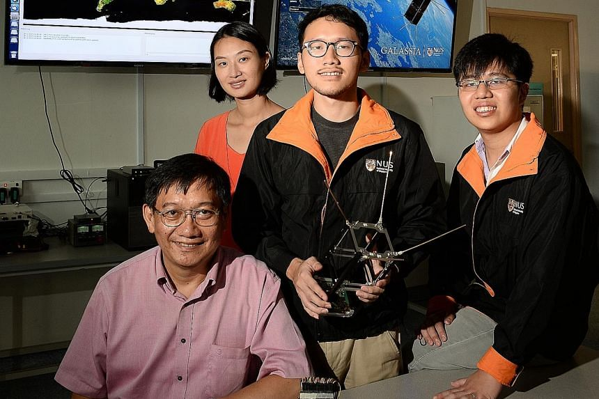 From left: Professor Goh Cher Hiang, project director, Dr Luo Sha, project supervisor, Mr Ajie Nayaka Nikicio, hardware engineer, and Mr Eugene Ee, systems engineer.