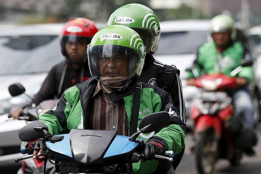 President Joko Widodo rebuked Transport Minister Ignasius Jonan's move to ban services such as Uber and Go-Jek (above), just months after he had invited dozens of Go-Jek motorbike drivers to lunch at his palace.