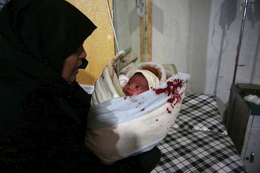 An injured baby inside a field hospital after what activists said were missile and air strikes in the Douma area of Damascus last Sunday.