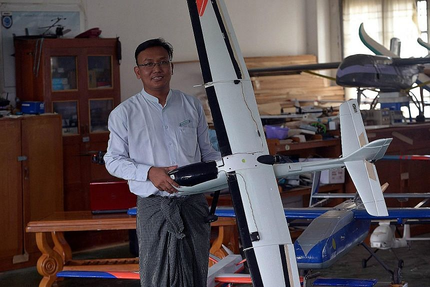 Mr Thae Maung Maung, head of the department for Unmanned Aerial Vehicles, with one of his self-made unmanned aerial vehicles at the Myanmar Aerospace Engineering University in Meiktila, in the Mandalay region in central Myanmar.