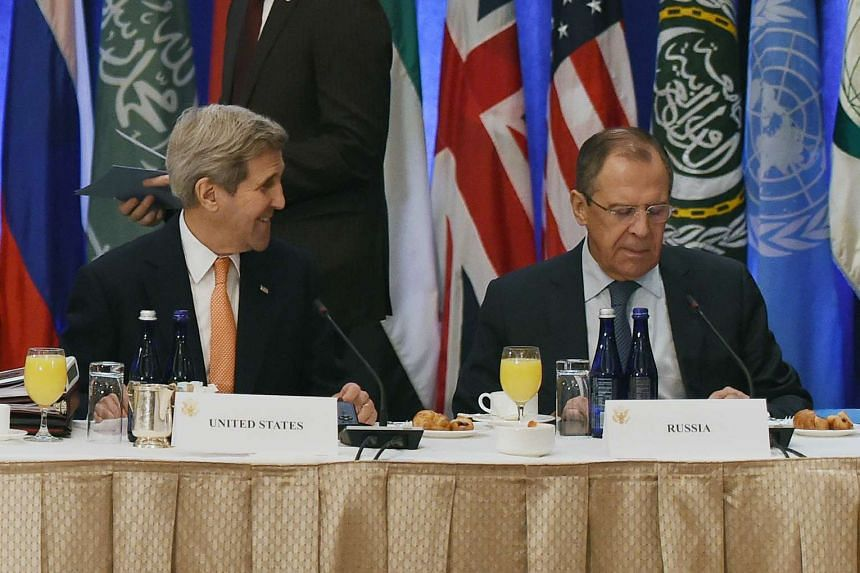 US Secretary of State John Kerry (left) talks to Russian foreign minister Sergey Lavrov before the meeting.