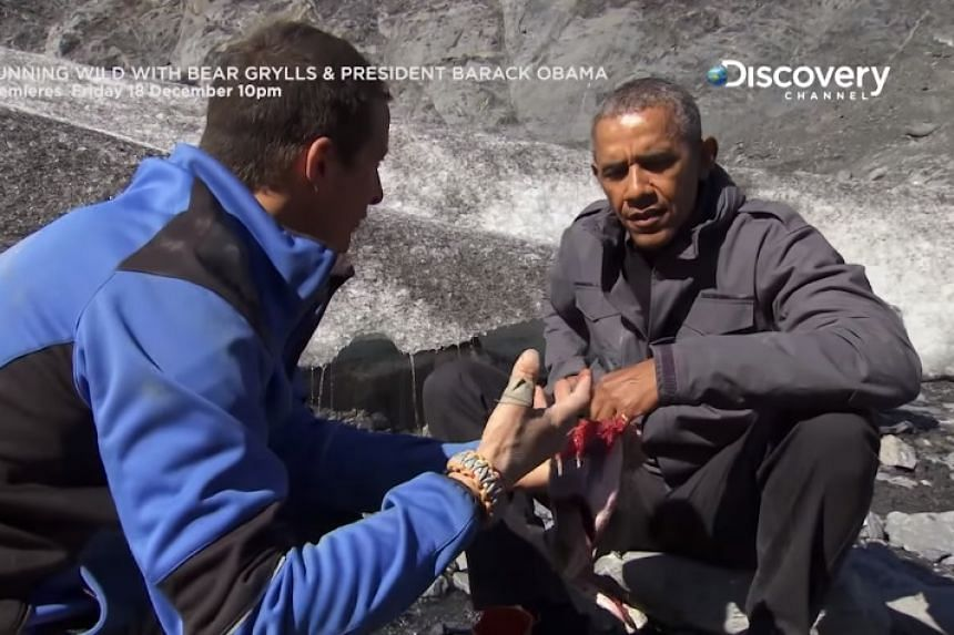 Obama and Bear Grylls (left) ate a half-eaten salmon left by a bear by a riverbed.