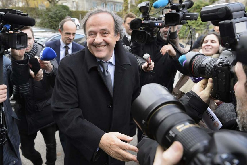 UEFA president Michel Platini (centre) arrives for a hearing on Dec 8, 2015.