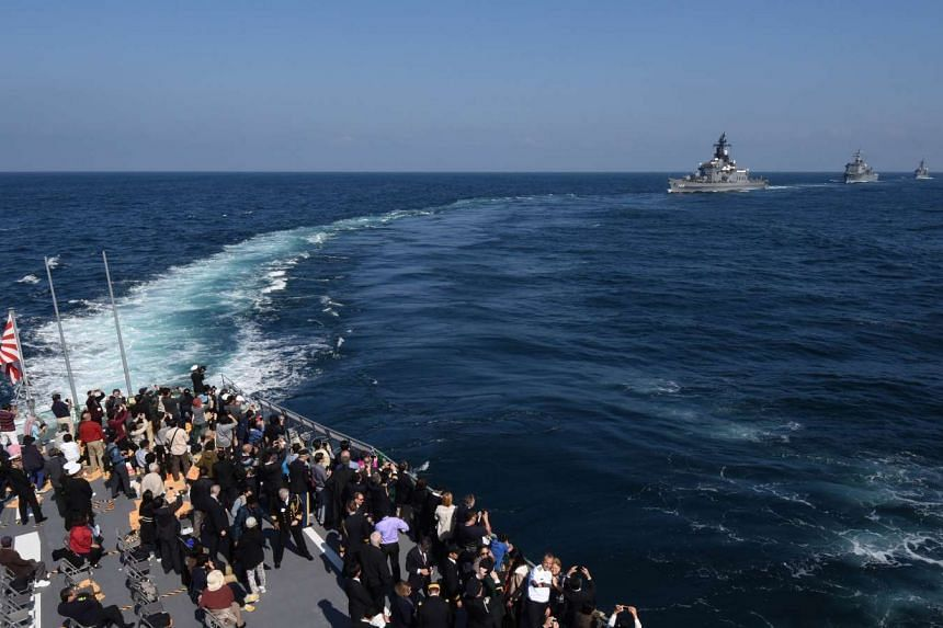 Ships from Japan's Maritime Self-Defence Force taking part in a fleet review off Sagami Bay in Kanagawa prefecture in October. The US also took part in the naval display that signalled wider engagement by its navy in the Western Pacific.