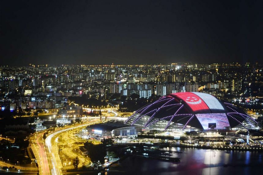 A giant Singapore flag on the roof of the National Stadium during the 28th SEA Games Opening Ceremony on June 5, 2015.