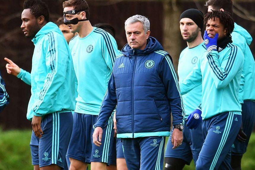 Mourinho (centre) leading team training on Dec 8, 2015.