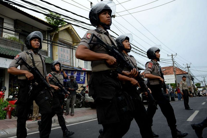 Indonesian police arrested five members of an alleged extremist network in raids across several cities in Java on Friday and Saturday.