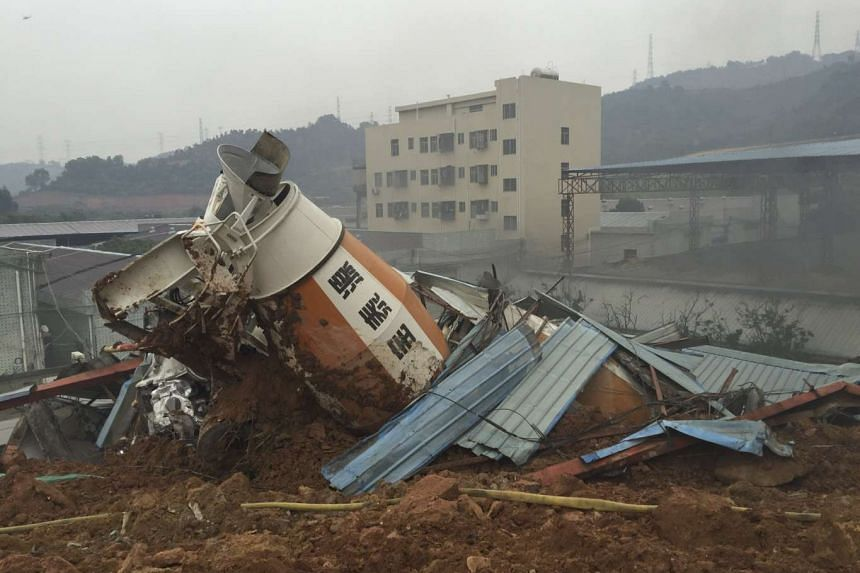 A damaged vehicle is seen among the debris at an industrial park after a landslide in Shenzhen, Guangdong province on Dec 20, 2015.