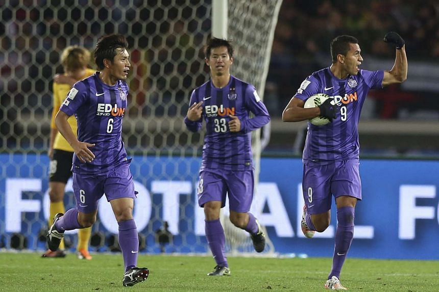 Sanfrecce Hiroshima's Douglas (right) celebrating after scoring during the FIFA Club World Cup match against Guangzhou Evergrande in Yokohama on Dec 20, 2015.