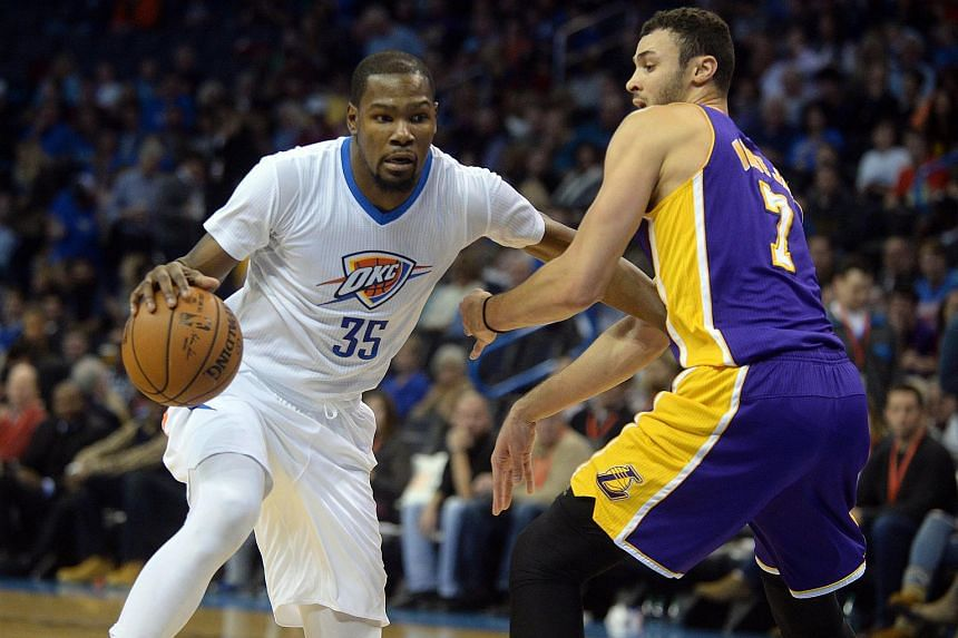 Oklahoma City Thunder forward Kevin Durant (left) drives to the basket against Los Angeles Lakers forward Larry Nance Jr. (right) at Chesapeake Energy Arena on Dec 19, 2015.