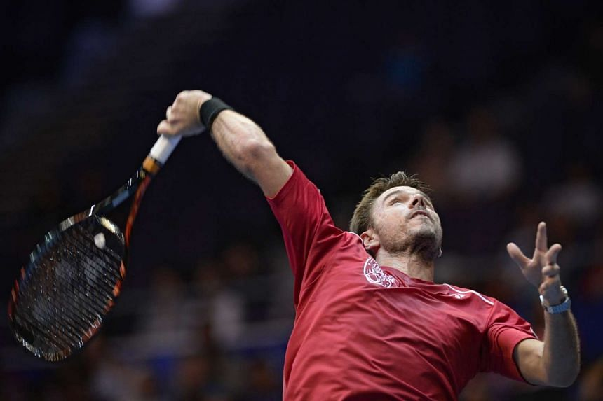 Stan Wawrinka preparing to hit a shot to Bernard Tomic during the IPTL in Singapore.