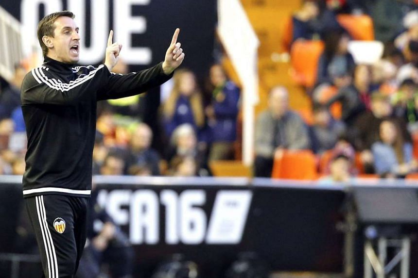 Valencia head coach Gary Neville giving instructions to his players during their Primera Division match against Getafe on Dec 19, 2015.