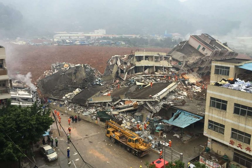 Rescuers working on the collapsed factory buildings after they were hit by a landslide in Shenzhen in south China's Guangdong province on Dec 20, 2015.