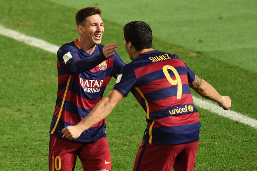 Barcelona forwards Lionel Messi (left) and Luis Suarez celebrating after Messi scored during the Club World Cup football final in Yokohama on Dec 20, 2015.