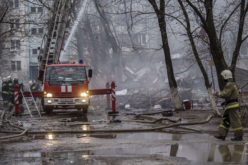 Firefighters working near a damaged 9-storey residential building following a gas explosion in Volgograd, Russia, on Dec 20, 2015.