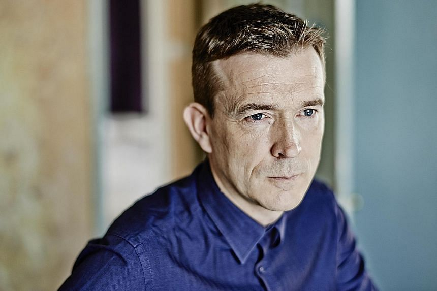 British author David Mitchell returns to the world of his mammoth oeuvre, The Bone Clocks, in Slade House.