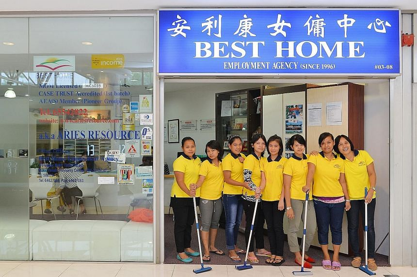 MOM's new requirement increases transparency by providing employers and maids - such as these at Best Home Employment Agency at Thomson Plaza - more information on their employment terms.