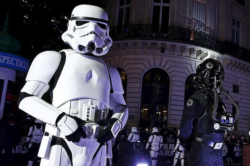 Australian fans Andrew Porters and Caroline Ritter had a Star Wars-themed wedding in the forecourt of the TCL Chinese Theatre in Hollywood, California, last Thursday. The latest Star Wars film has ignited a fresh round of debates, one of which is `th
