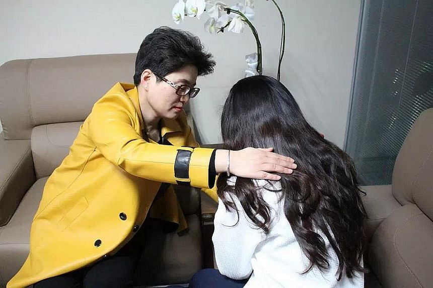 """Ms Ming Li (left) runs a Shanghai-based marriage counselling firm with 30 staff, including """"xiaosan quantuishi"""" or """"mistress dissuaders"""". This is a growing and lucrative trade in China, where divorce rates have risen for 12 years straight, with extra"""
