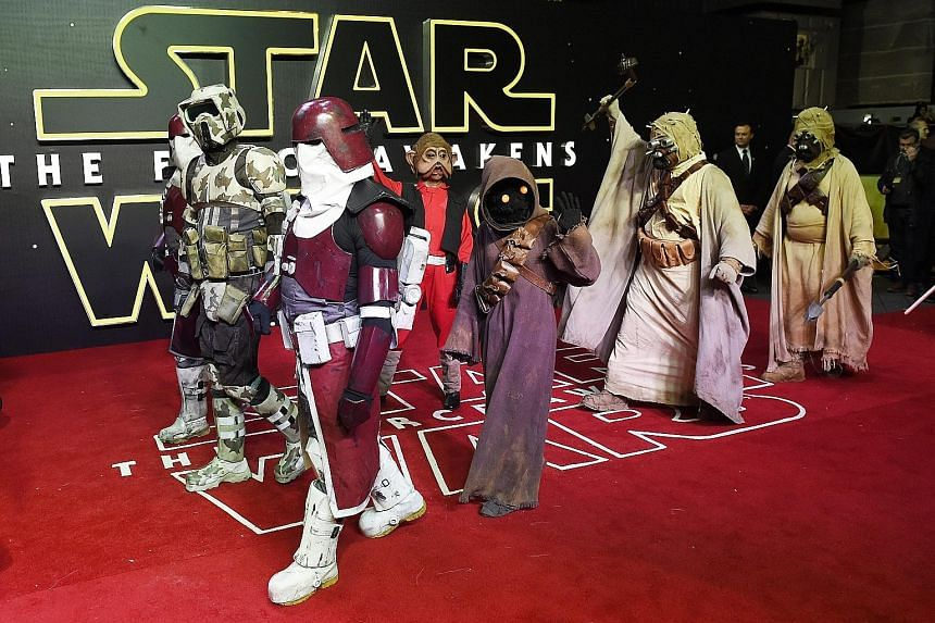 George Lucas, director of the first Star Wars movie, became a billionaire when he waived a portion of his salary for the film in exchange for merchandising rights. Left: The European premiere of Star Wars: The Force Awakens in Leicester Square, Londo