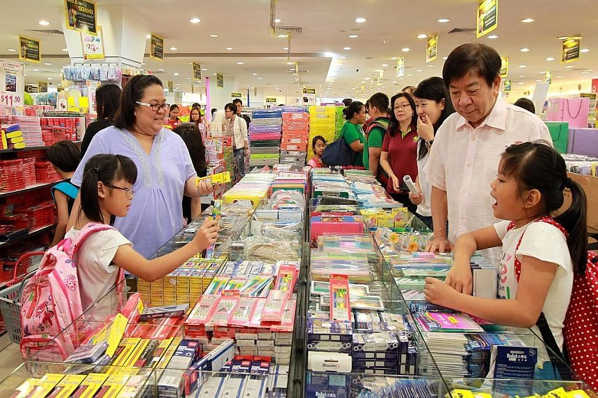 Mr Khaw, MP for Sembawang GRC, joined the children at Northpoint mall's Popular bookstore as they shopped for school materials ahead of the new school year.