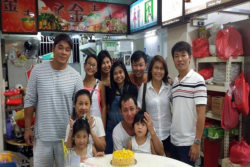 Mr Lee with his ex-wife, Carol, (seated) and children and grandchildren. It is his drive to not fail his grandchildren that has kept Mr Lee on the straight and narrow.