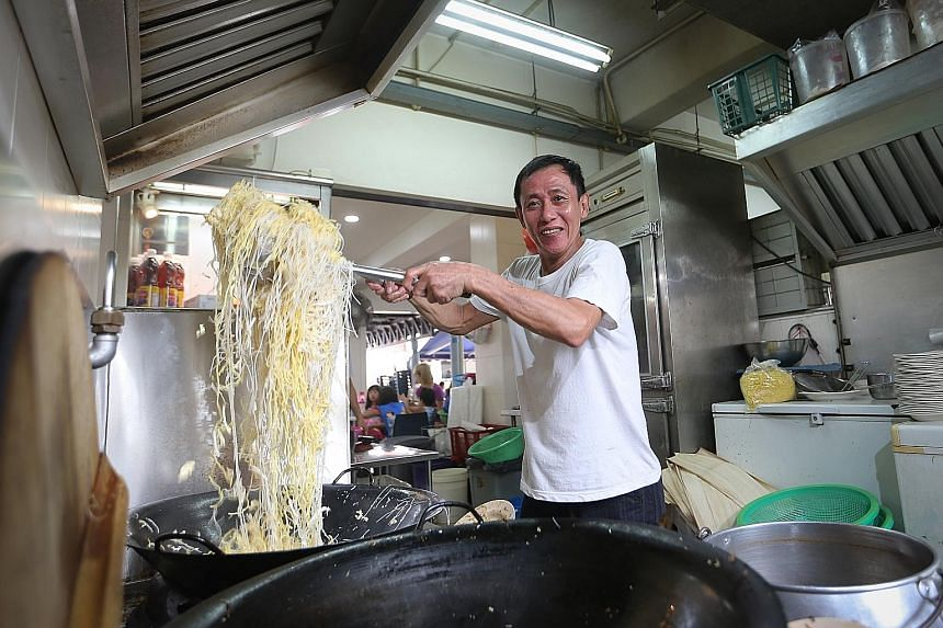 Mr Lee Eng Keat has put his criminal past behind him and is now doing a roaring trade selling Hokkien mee. His stall, Kim Keat Fried Hokkien Mee, is known for serving the noodles in claypots or on opeh leaves.